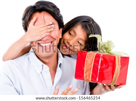 Happy girl giving her father a surprise present - isolated over white  - stock photo