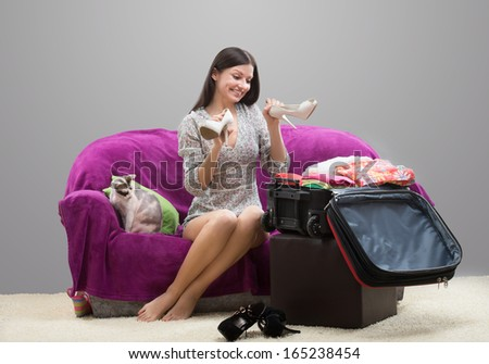 Happy girl going on holiday - stock photo