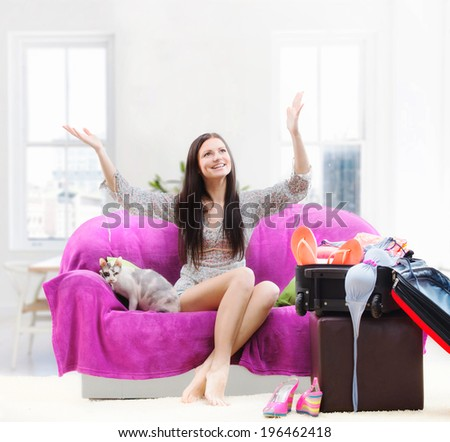 Happy girl going on vacation - stock photo