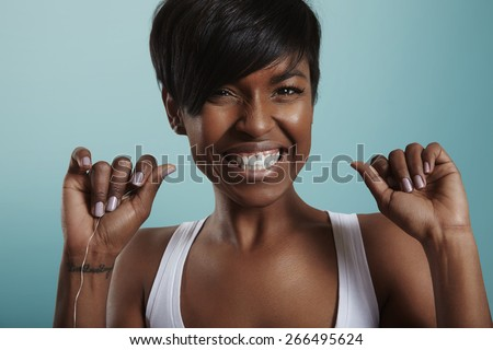 happy girl have fun with a tooth floss. tooth care. white smile - stock photo