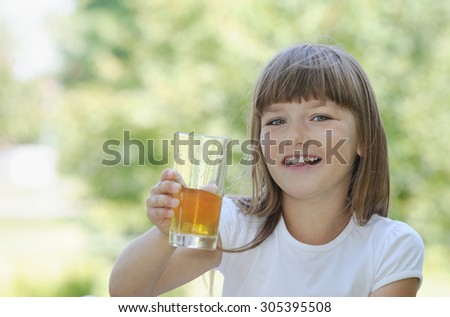 happy girl having fun on picnic in the park in sunny summer day, happy family concept - stock photo