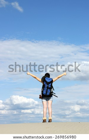 happy girl hiker with thumbs up in desert - stock photo