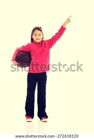 Happy girl holding basket ball - stock photo
