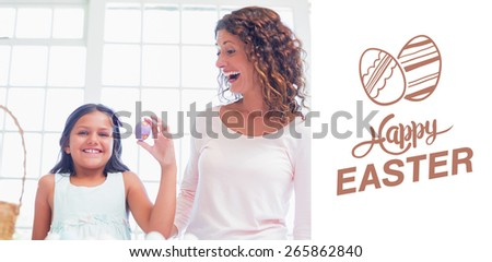 Happy girl holding easter egg against happy easter graphic - stock photo