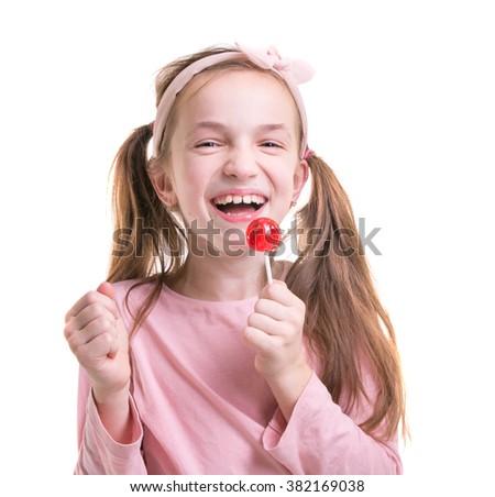 Happy girl holding lollipop. Isolated on white - stock photo