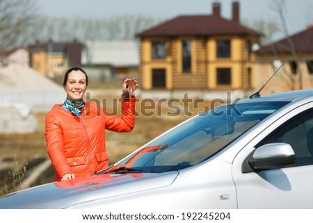 happy girl holding the keys car   - stock photo