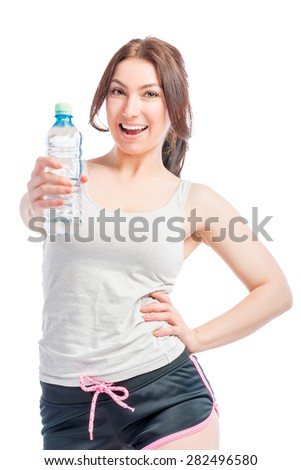 happy girl holds a bottle of drinking water