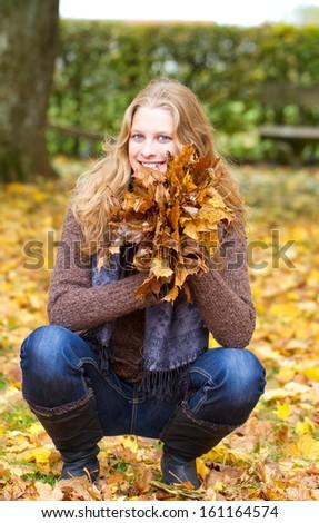 Happy girl in autumn - stock photo