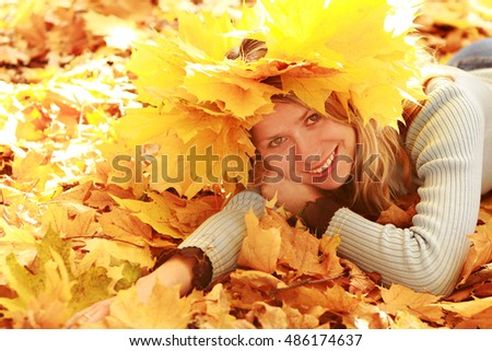 happy girl in autumn park portrait on nature