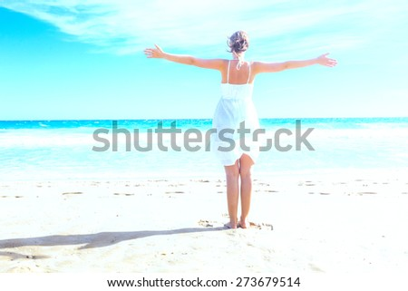 happy girl in blue lagoon - stock photo