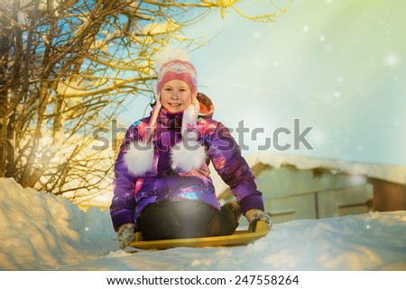 Happy girl in  clothes in winter outdoors - stock photo