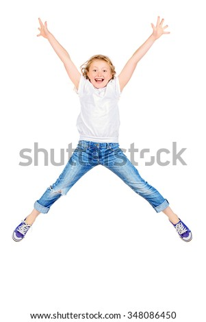 Happy girl in jumping for joy. Studio shot. Isolated over white.  - stock photo