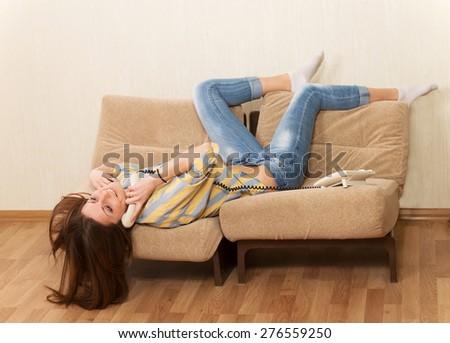 Happy girl in love talking to telephone - stock photo