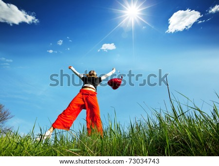 Happy girl in mountains - stock photo