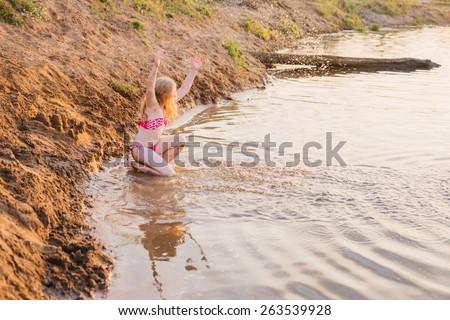 happy girl in river - stock photo