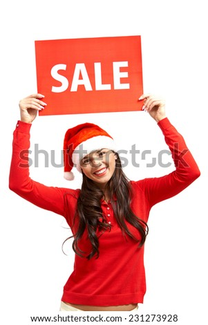 Happy girl in Santa cap showing red card announcing sale - stock photo