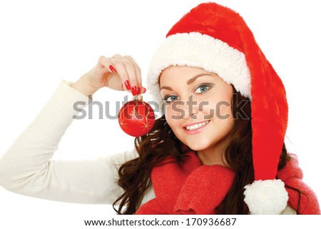 Happy girl in santa hat with christmas ball isolated on white background