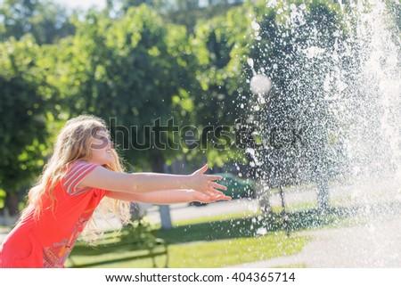 happy girl in summer park - stock photo
