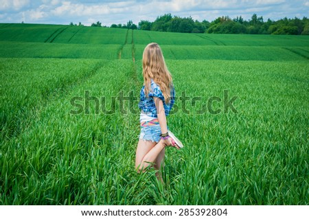 happy girl in the green field - stock photo
