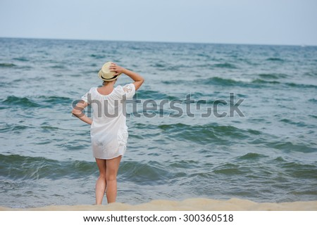 happy girl in white dress  on the sea beach