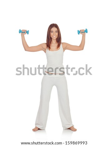 Happy girl in white toning her muscles isolated