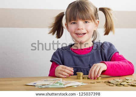 Happy girl is playing with money - stock photo