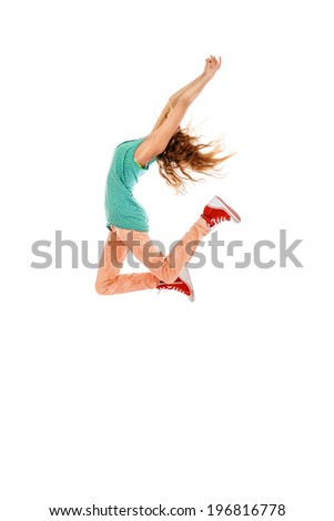 beautiful female hip hop dancer striking a dance pose