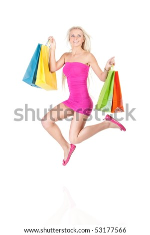 happy girl jumping with colorful shopping bags in her hands - stock photo