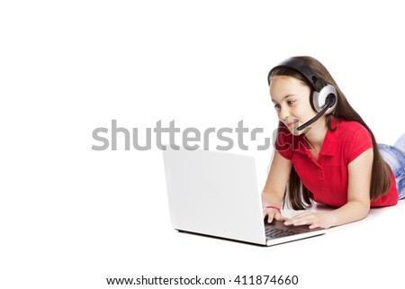 Happy Girl listening music on laptop isolated on white - stock photo