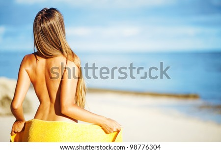 happy girl near swimming pool, bali resort hotel - stock photo