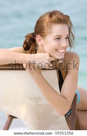 happy girl on beach - stock photo