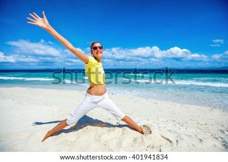 Happy girl on the beach - stock photo