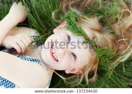 happy girl on the grass - stock photo