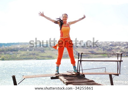 happy girl on the lakeside - stock photo