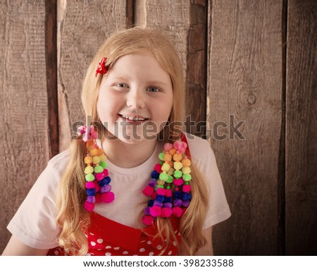 happy girl on wooden background - stock photo