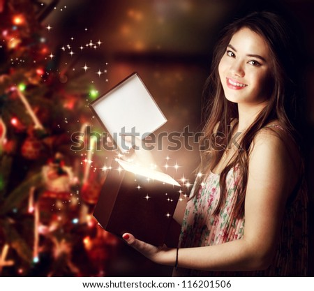 Happy Girl Opening a Gift Box