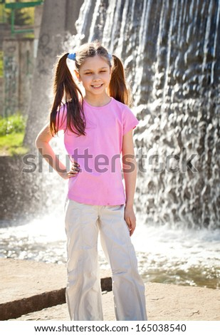 Happy girl playing outdoors in spring park - stock photo