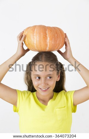 Happy Girl Playing with Pumpkin, Eating Healthy Food - stock photo