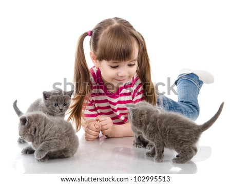 happy girl plays with a cats. isolated on white background