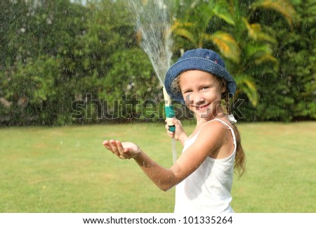 Happy girl pours a water - stock photo