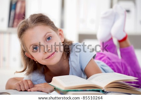 happy girl reading books - stock photo
