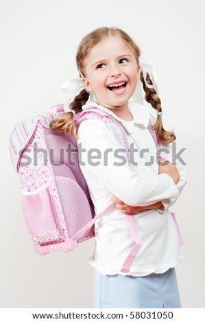 Happy girl ready for school - stock photo