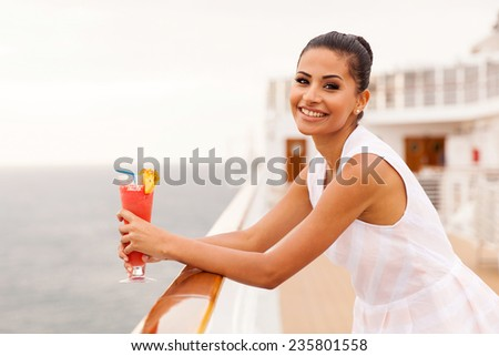 happy girl relaxing on cruise drinking cocktail - stock photo