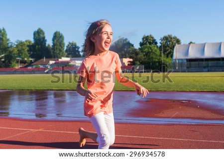 Happy girl run on the track