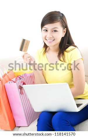 Happy girl saving time and money doing purchases online