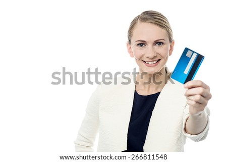 Happy girl showing her cash card to camera