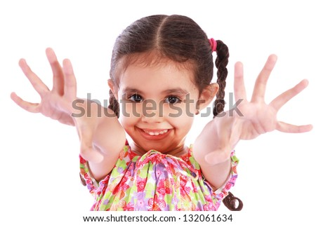 Happy girl  showing ten fingers over white background