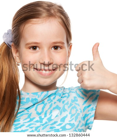 Happy girl showing thumb up. Happiness child showing sign okay - stock photo