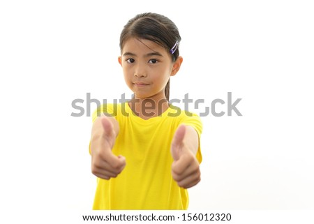 Happy girl showing thumbs up sign