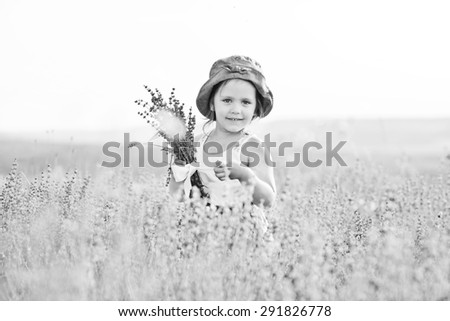 happy girl standing in the lavender field   - stock photo